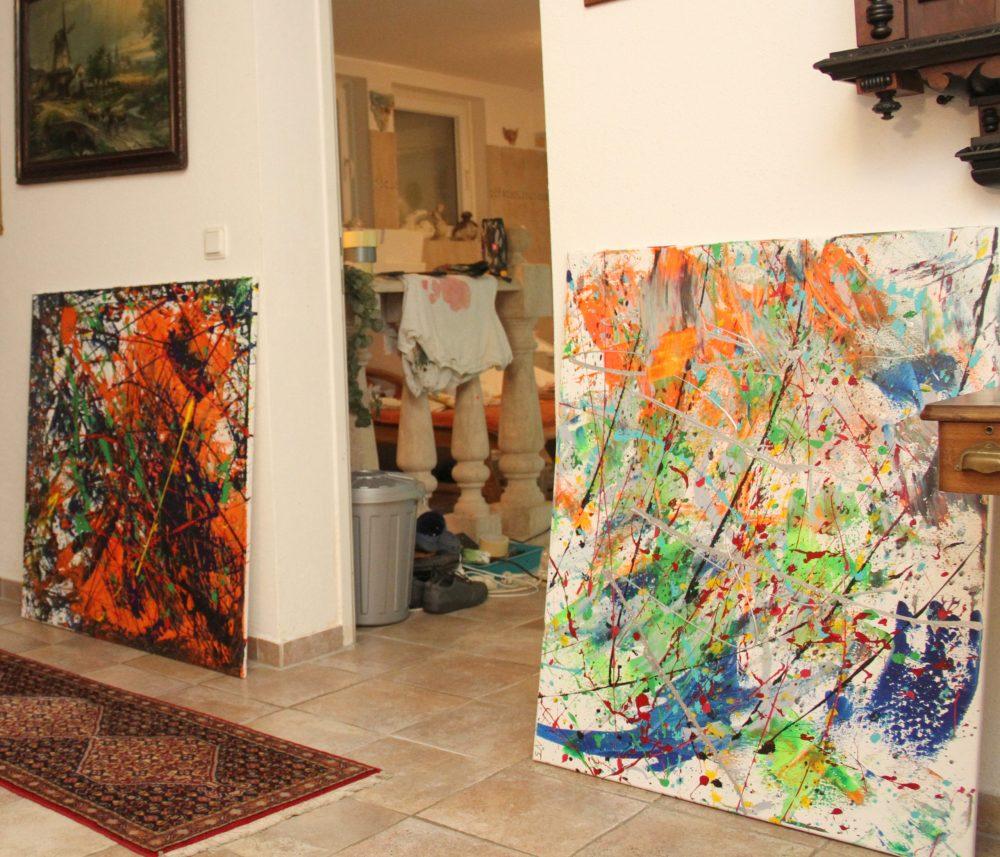 Gemalte Bilder an der Wand